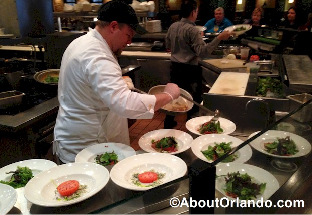 Review of Roy's Cooking Class in Orlando on Sand Lake Drive from About Orlando. Preparing the wilted spinach salad with white balsamic vinegar dressing.